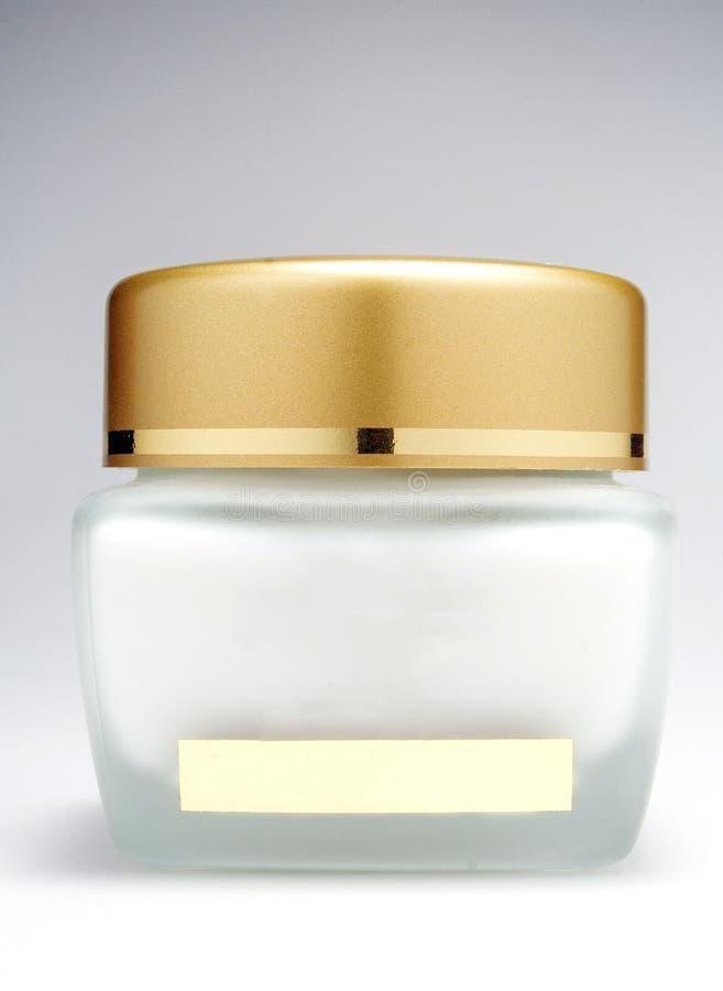 Bottiglia crema dei cosmetici con un fondo bianco fotografia stock