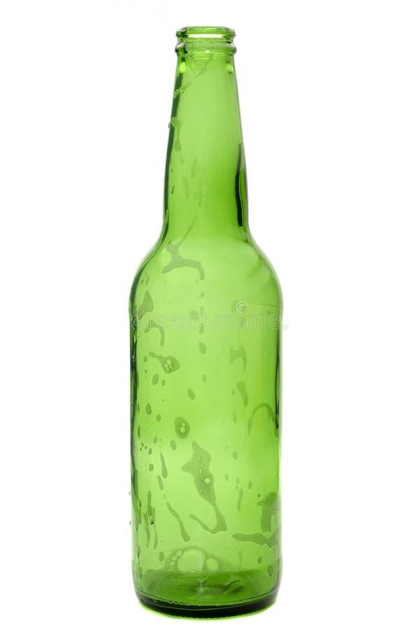 Bottiglia da birra vuota verde fotografia stock