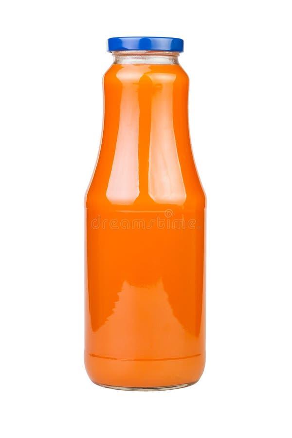 Bottiglia del succo di carota fotografia stock
