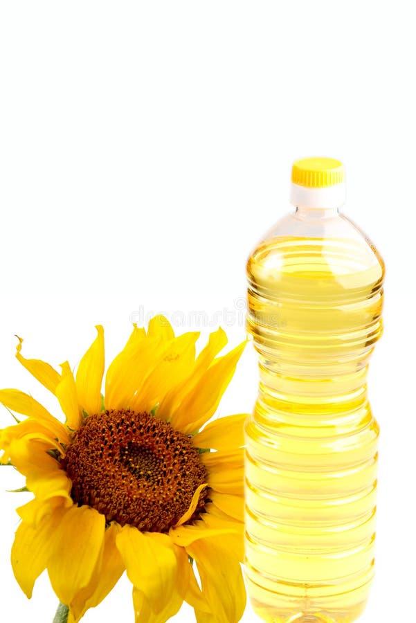 Bottiglia dell'olio del seme di girasole fotografia stock libera da diritti