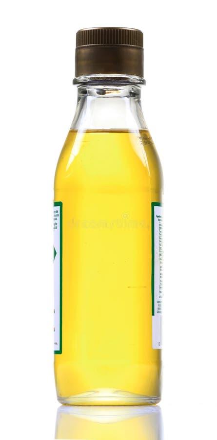 Bottiglia dell'olio del seme di lino fotografie stock libere da diritti