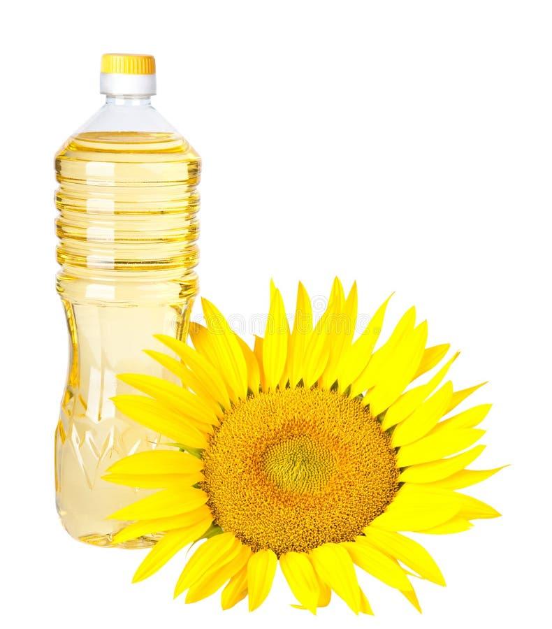 Bottiglia dell'olio di girasole con il fiore isolato immagini stock