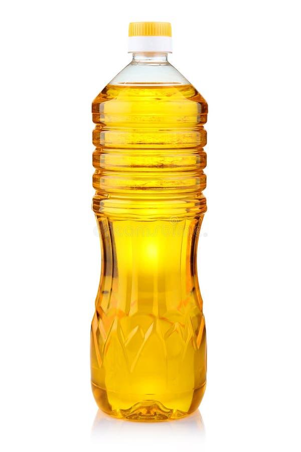 Bottiglia dell'olio di girasole su bianco fotografia stock libera da diritti