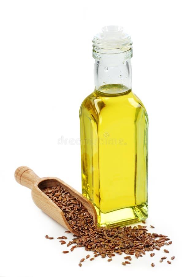 Bottiglia dell'olio di lino immagine stock