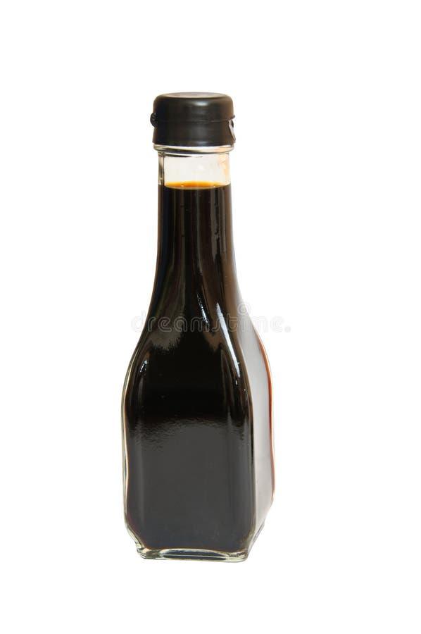 Bottiglia della salsa di soia isolata su priorità bassa bianca fotografia stock