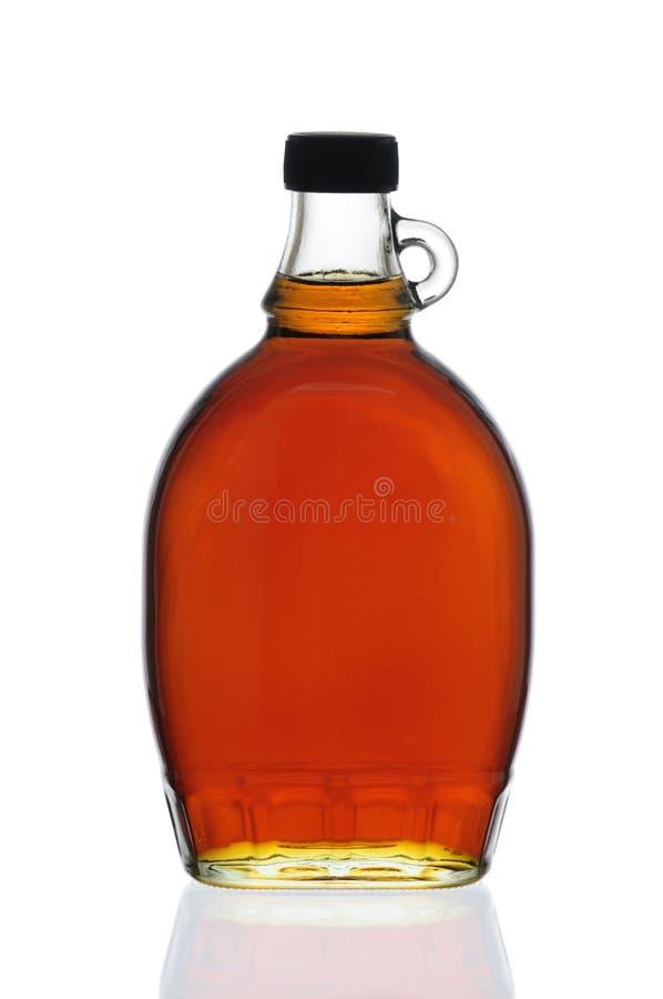 Bottiglia dello sciroppo di acero fotografia stock
