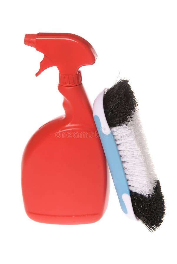 Bottiglia dello spruzzo del pulitore con la spazzola fotografia stock