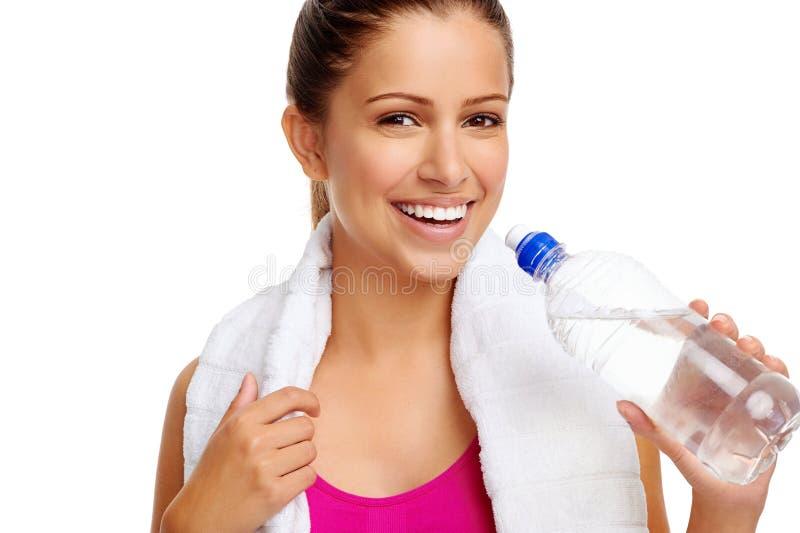 Bottiglia di acqua sana della donna immagine stock libera da diritti