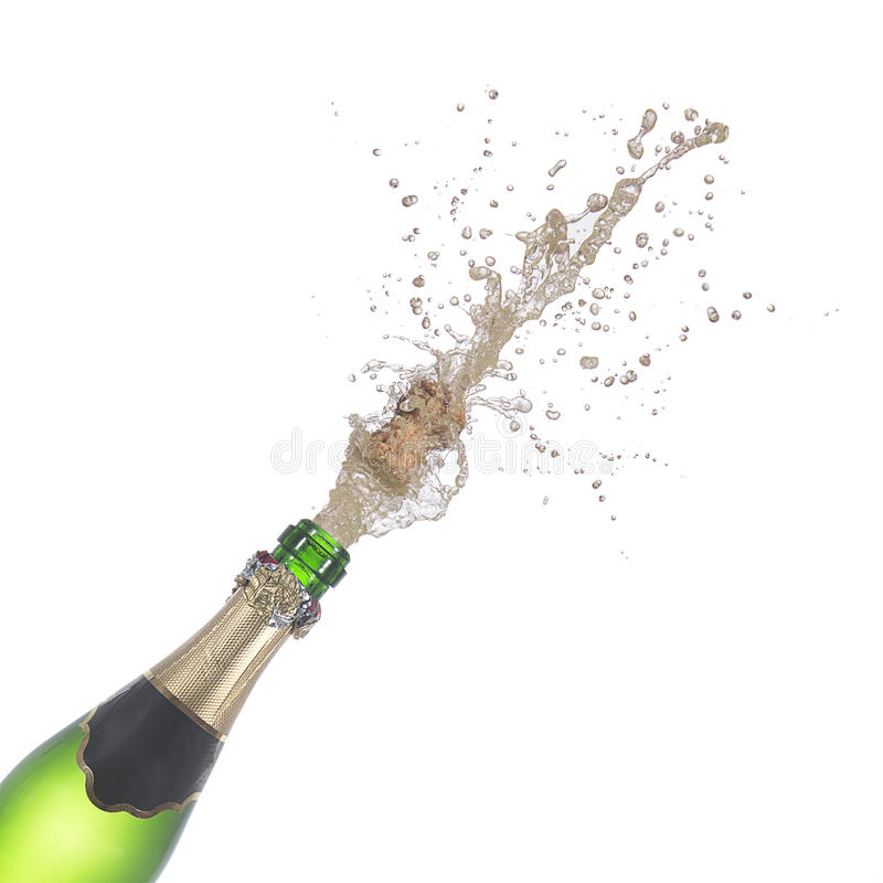 Bottiglia di champagne schioccando il suoi sughero e spruzzatura fotografie stock