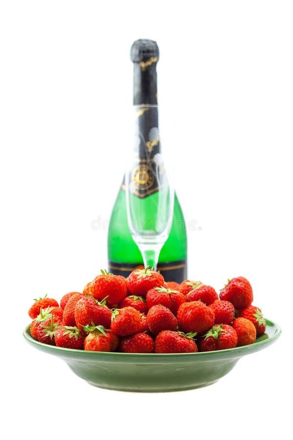 Bottiglia di champagne, vetro di vino fotografia stock