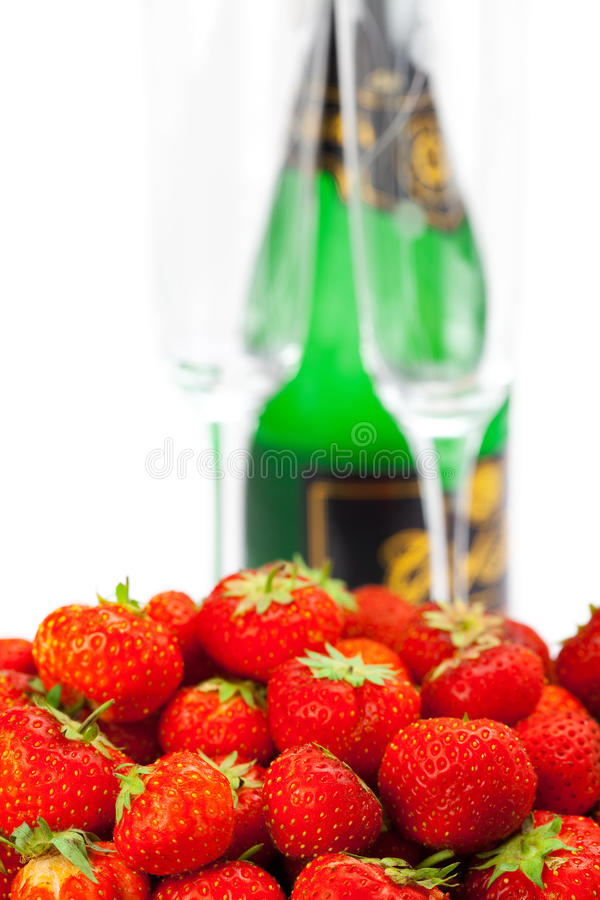 Bottiglia di champagne, vetro di vino immagini stock
