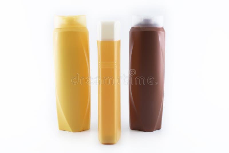 Bottiglia di fucilazione dello sciampo Fondo astratto nel colore bianco È stato contenuto lo studio immagini stock libere da diritti