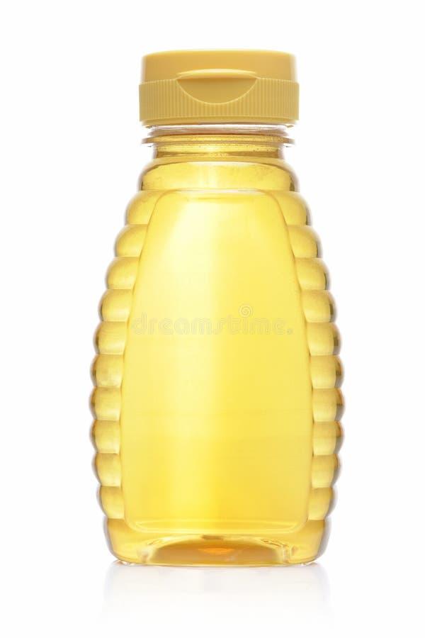 Bottiglia di miele fotografia stock
