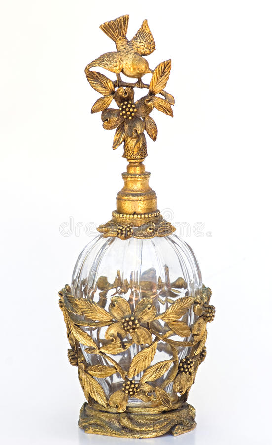 Bottiglia di profumo dell'annata dell'oro con l'uccello & il dogwood immagini stock
