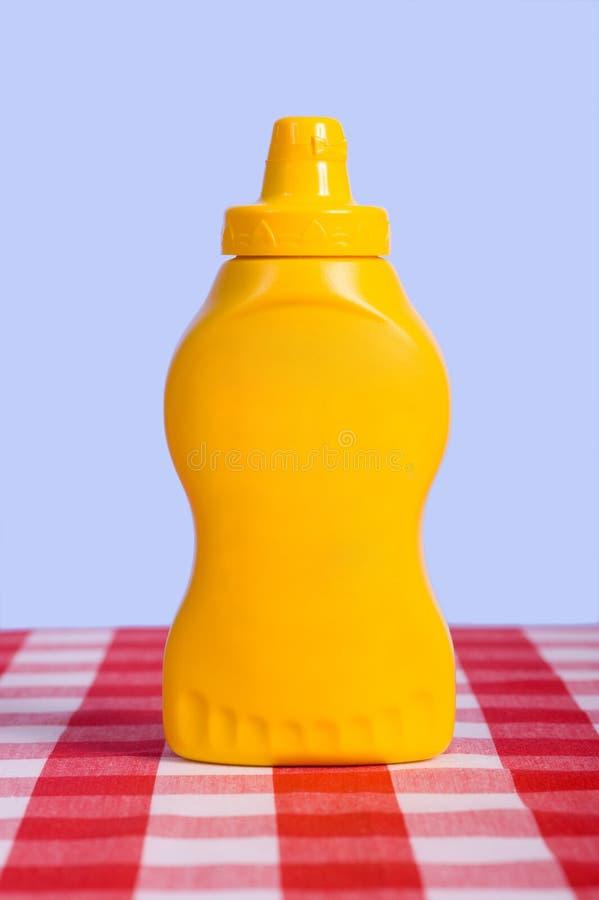 Bottiglia di senape fotografia stock