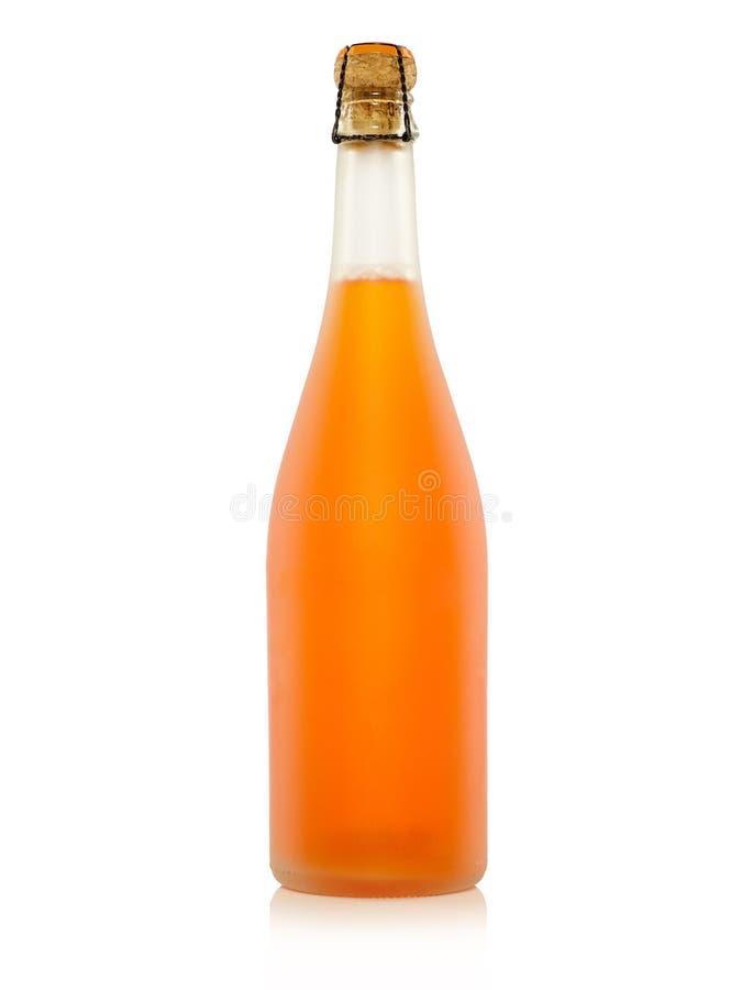 Bottiglia di spremuta fotografia stock