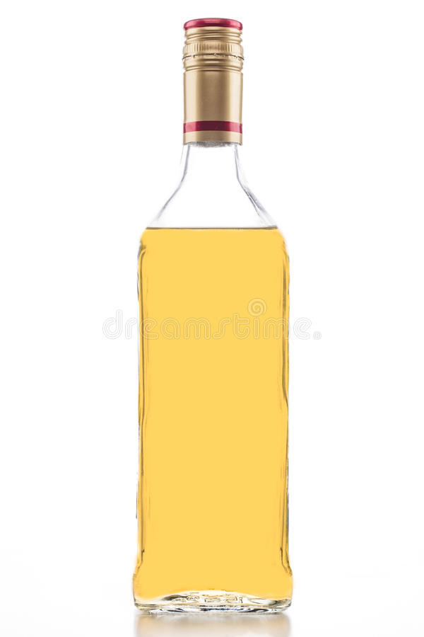 Bottiglia di tequila dell'oro fotografia stock libera da diritti