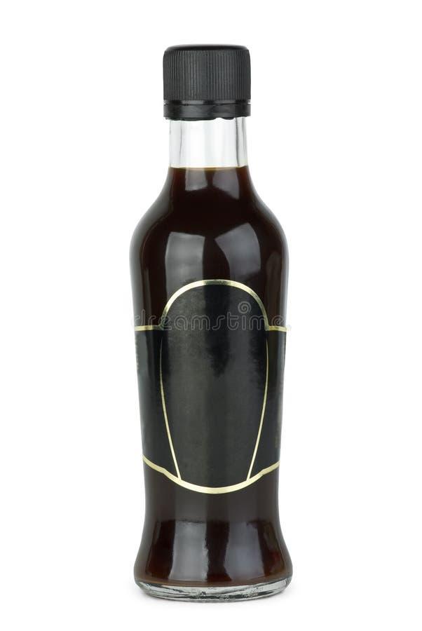 Bottiglia di vetro con la salsa di soia fotografie stock libere da diritti