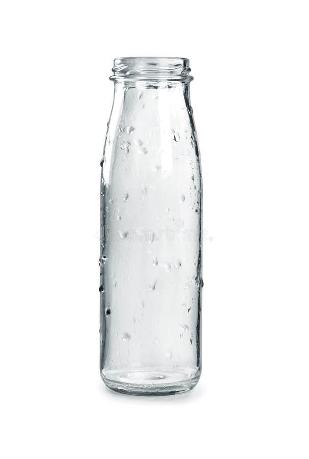 Bottiglia di vetro vuota su un fondo bianco fotografia stock libera da diritti