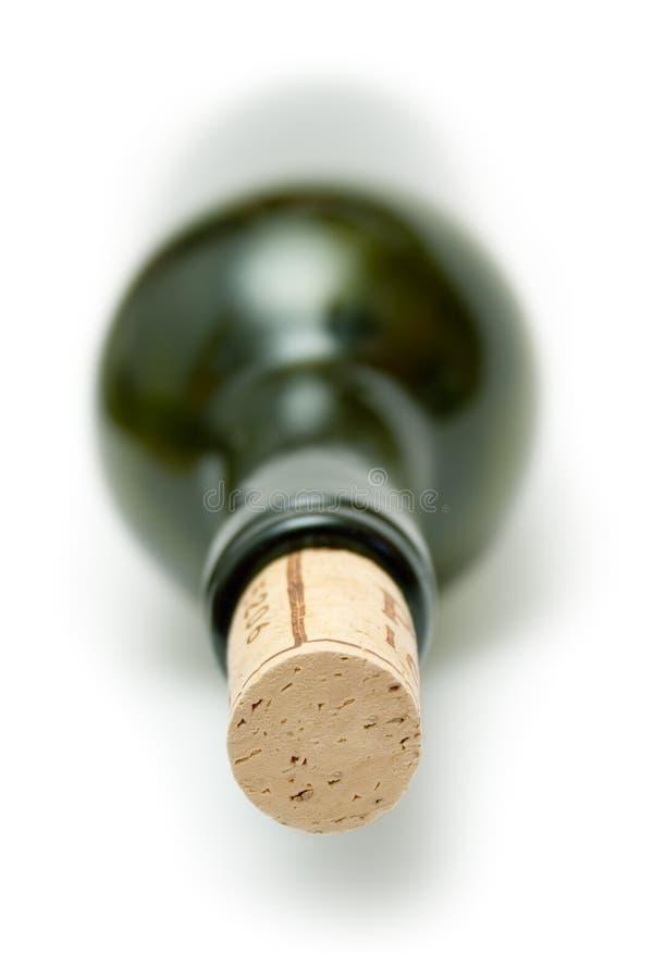 Bottiglia di vino verde tappata immagine stock