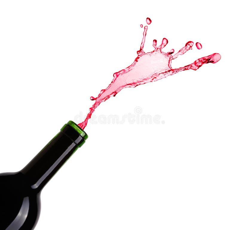 Bottiglia e spruzzata di vino fotografia stock