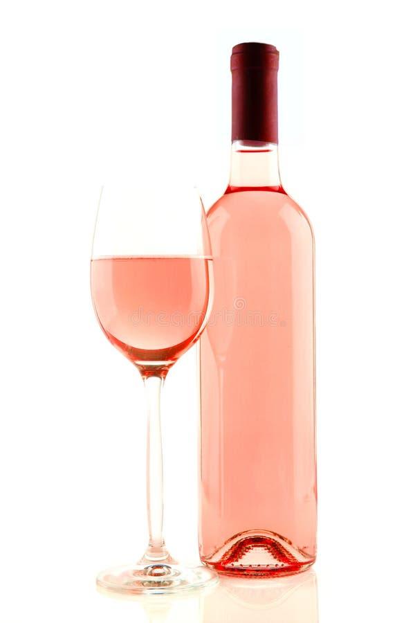 Bottiglia e vetro di vino rosato isolati fotografie stock