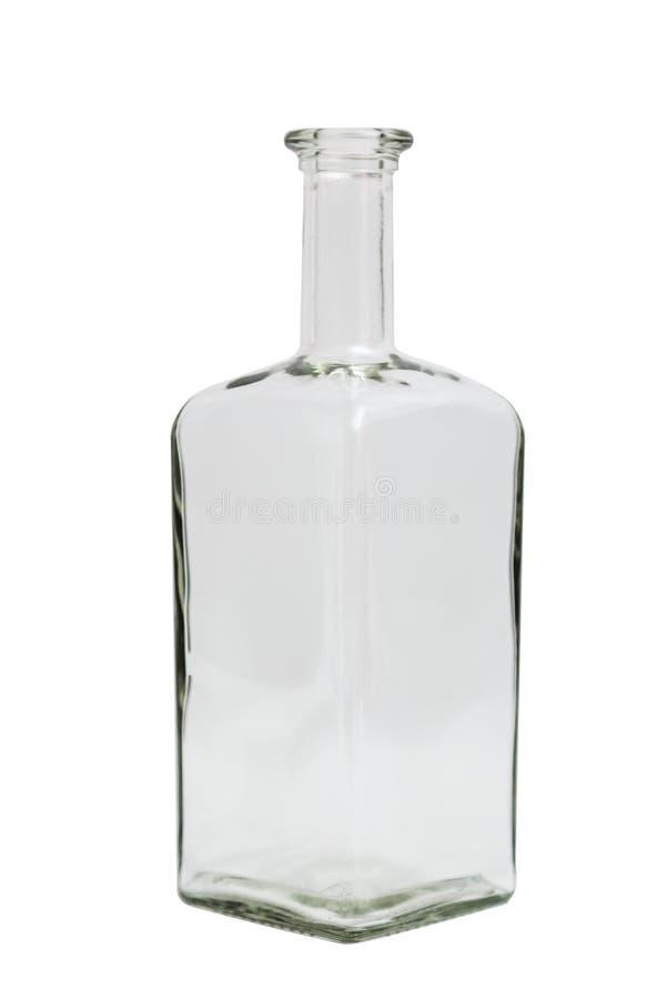 Bottiglia quadrata semplice vuota trasparente di vetro su fondo isolato fotografie stock