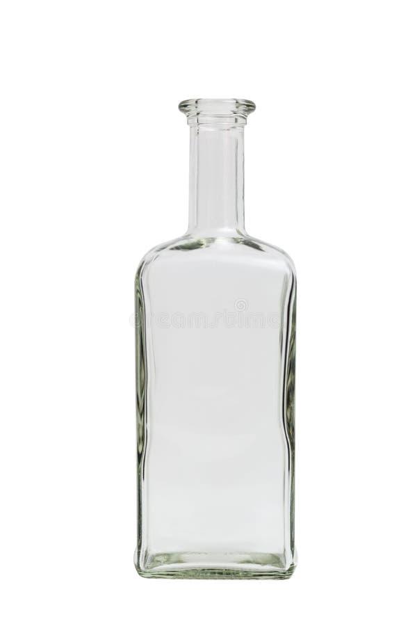 Bottiglia quadrata semplice vuota trasparente di vetro su fondo isolato fotografia stock