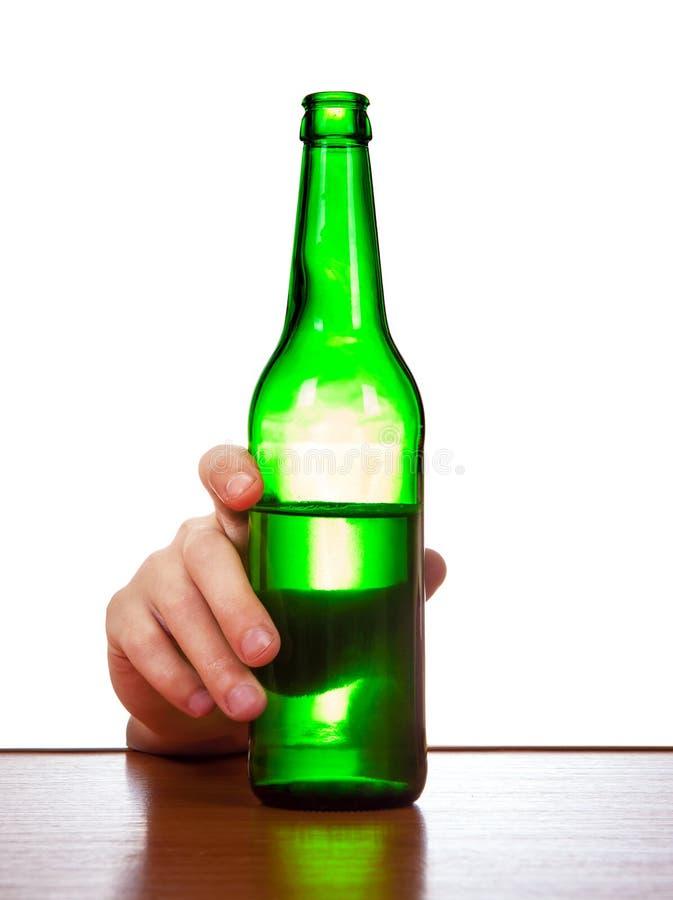 Bottiglia su una tavola immagine stock