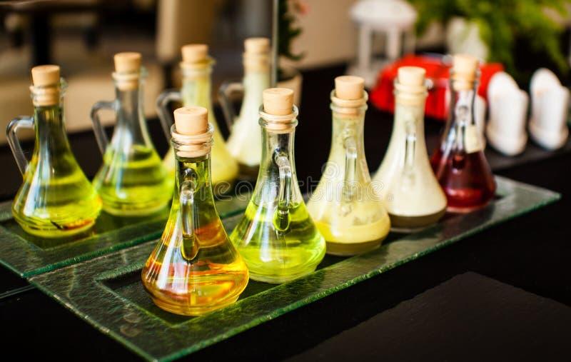 Bottiglie con olio differente immagini stock