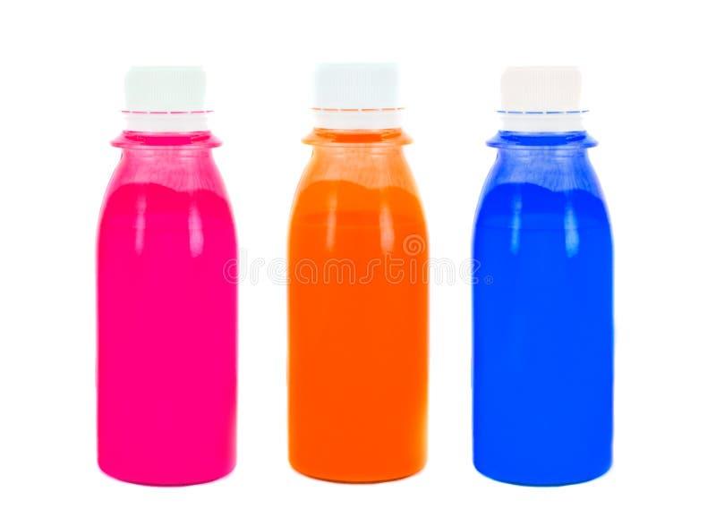 Bottiglie con una vernice. fotografia stock
