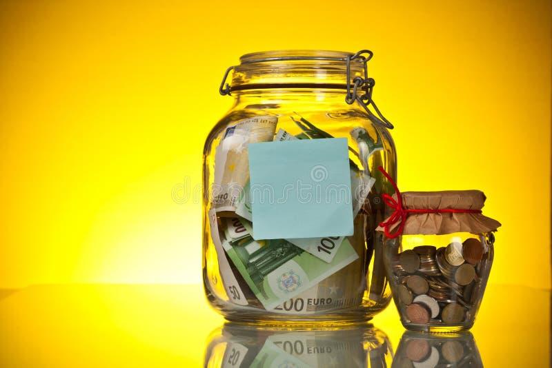 Bottiglie dei soldi dei contanti immagini stock libere da diritti