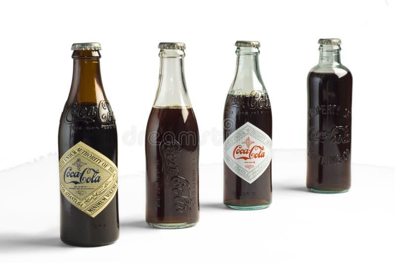 Bottiglie della coca-cola dell'annata fotografie stock libere da diritti