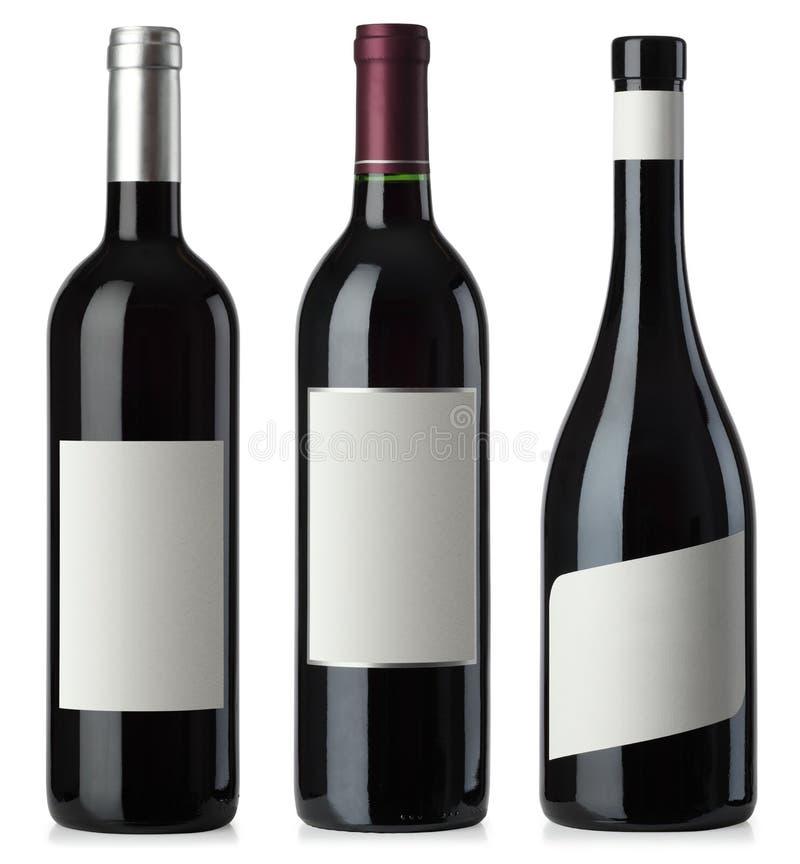 Bottiglie dello spazio in bianco del vino rosso con i contrassegni immagine stock libera da diritti