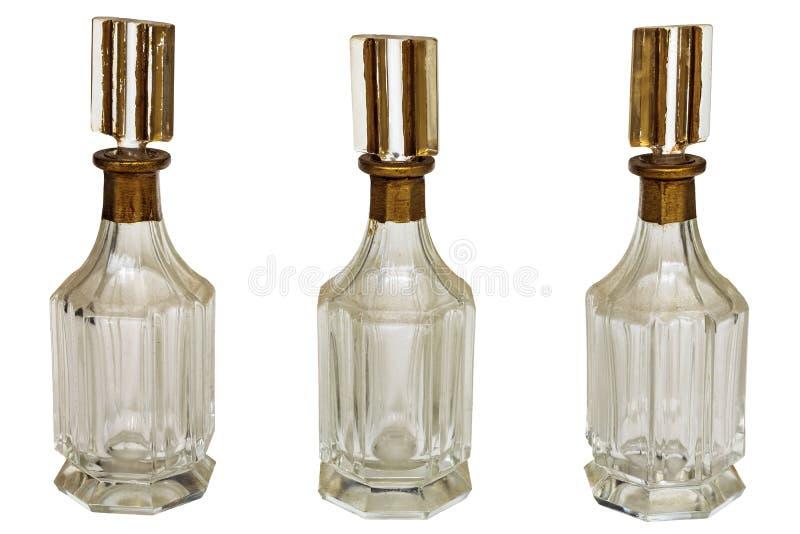 Bottiglie di art deco dell'annata isolate su bianco immagine stock