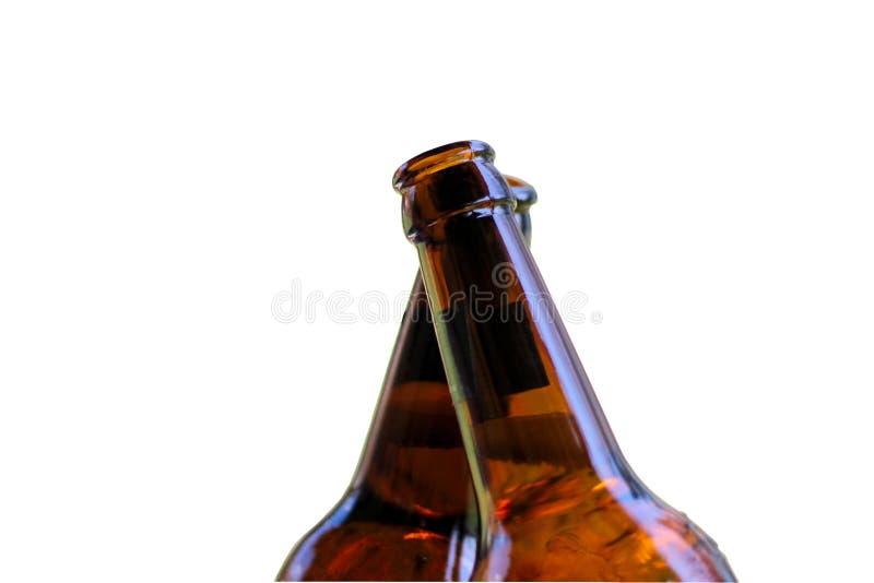 Bottiglie di birra attraversate immagine stock