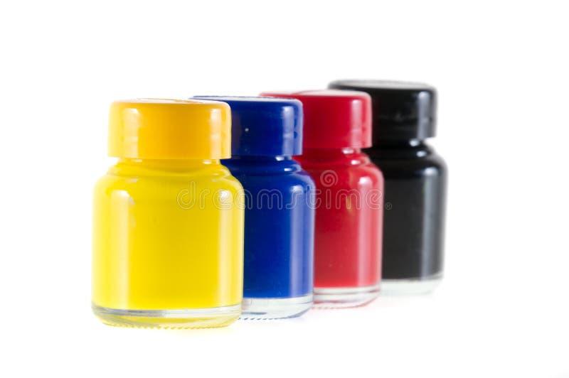 Bottiglie di inchiostro nei colori del cmyk immagine stock libera da diritti