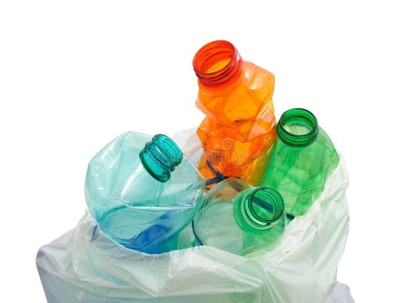 Bottiglie di plastica con il sacco fotografie stock libere da diritti