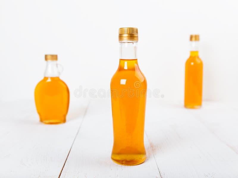 Bottiglie di sciroppo fotografie stock