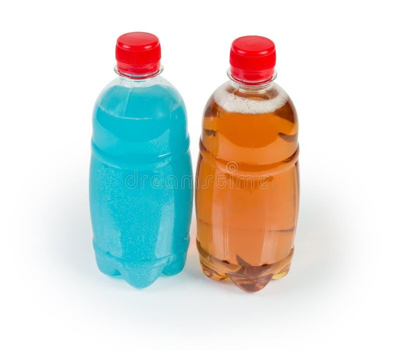 Bottiglie di sidro esotico tradizionale e blu su fondo bianco immagine stock libera da diritti