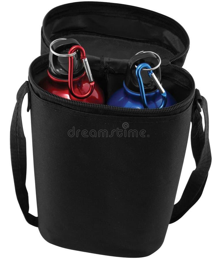 Bottiglie di sport con il sacchetto fotografia stock