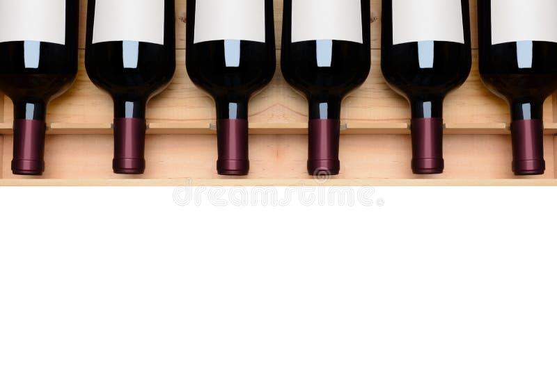 Bottiglie di vino nel caso etichette dello spazio in bianco fotografia stock