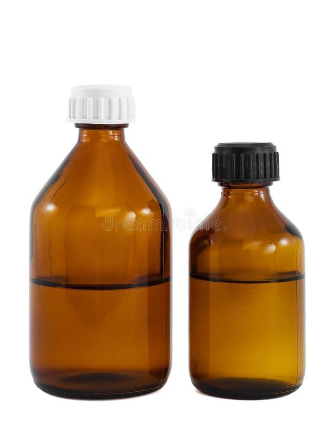 Bottiglie mediche di vetro del Brown immagini stock