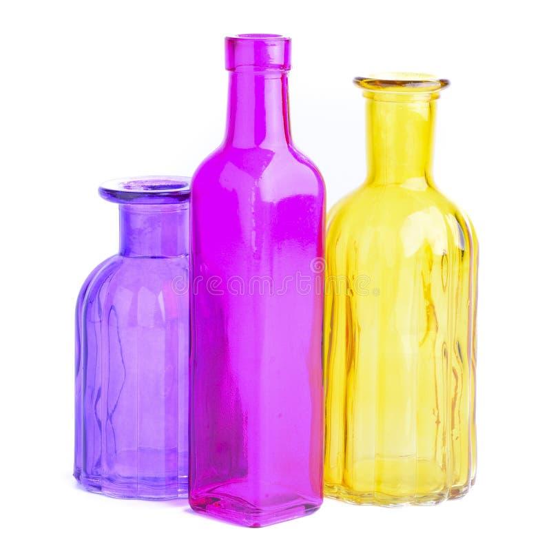 Download Bottiglie variopinte fotografia stock. Immagine di viola - 56880356