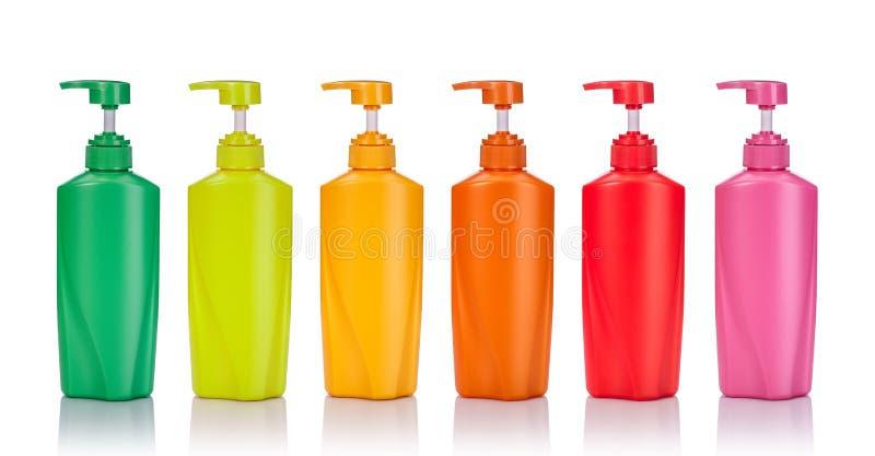 Bottl plástico verde, amarillo, rosado, anaranjado y rojo en blanco determinado de la bomba imágenes de archivo libres de regalías
