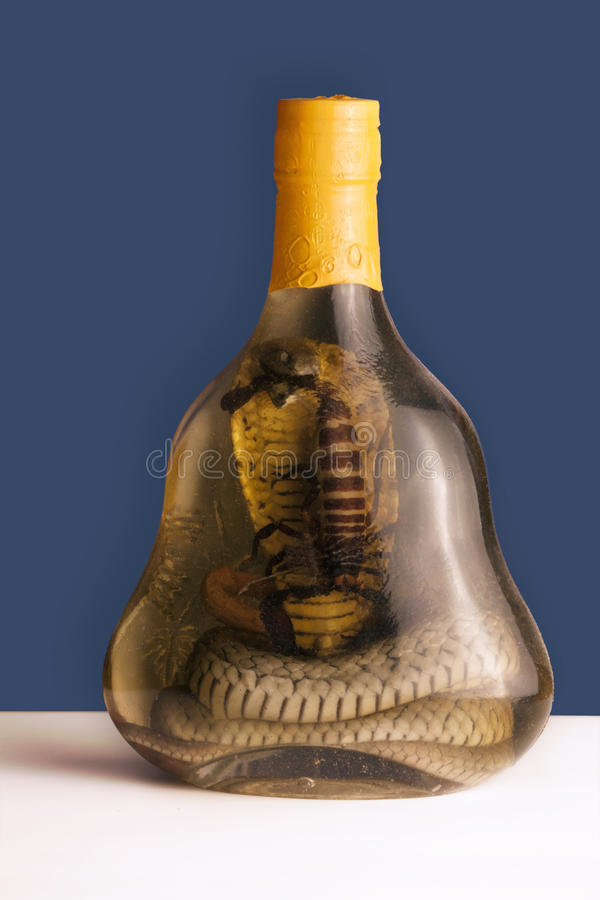 A bottle of Alcohol containing a Cobra snake and scorpion royalty free stock image