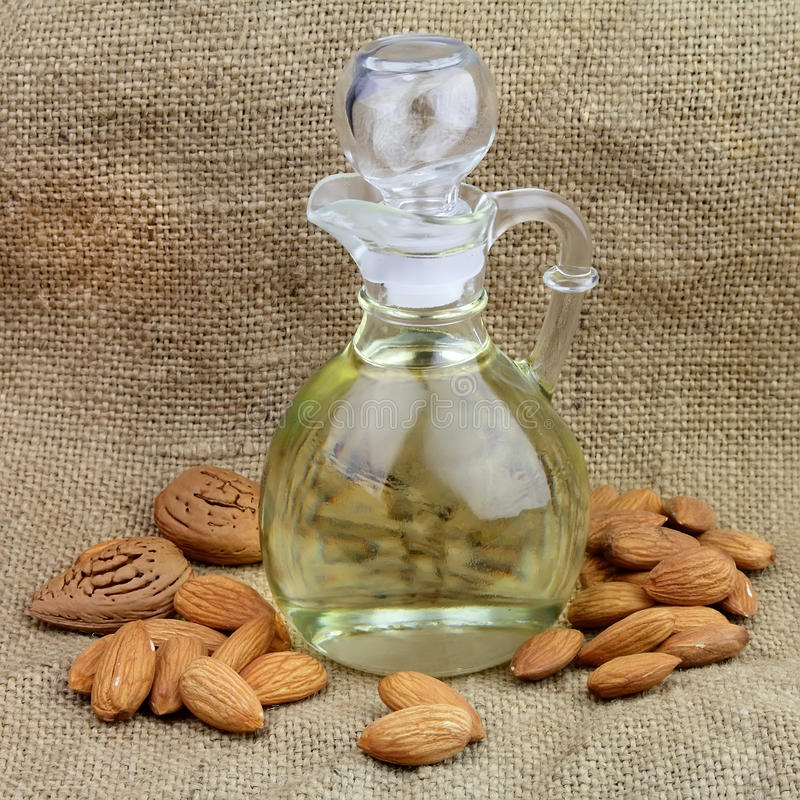 Download A Bottle Of Almond Oil With Nuts Stock Image - Image of aroma, branch: 22199659