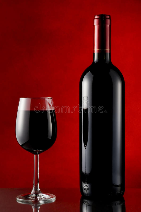 Free Bottle And Glass Of Red Wine Royalty Free Stock Image - 12369056