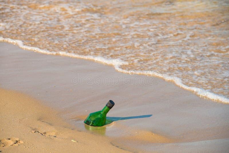 Bottle ashore royalty free stock image