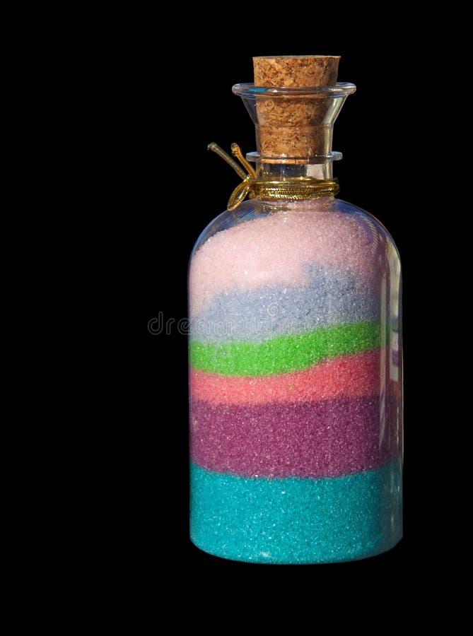 Bottle with bath salt on black background royalty free stock photography
